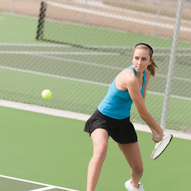 Eye on the tennis ball. by Matt Paepke - Sports & Fitness Tennis ( fitness, female, woman, exercise, tennis, athletic )