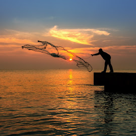 Catch by Arthit Somsakul - Landscapes Sunsets & Sunrises ( sillhouette, sunset, catch, bridge, net, neting, fisherman )