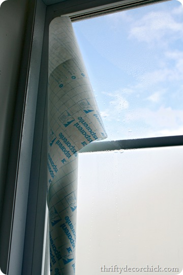 applying contact paper to window