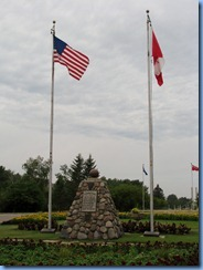 2358 North Dakota USA & Manitoba Canada - International Peace Garden - cairn of native stone right on border
