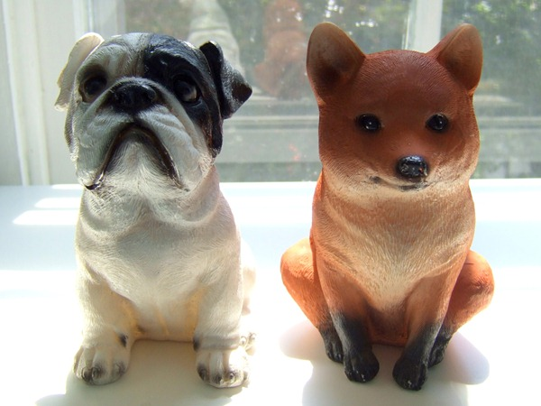 Plastic dog and fox