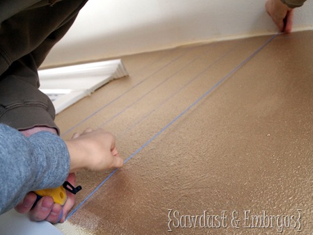 Using a Chalk Line for laying out Stencilling Grid {Sawdust and Embryos}