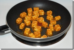 Fry paneer until golden-brown on both sides