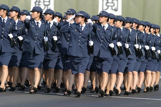 Female soldiers of the Japan Air Self-Defense Force salute their chief, Prime Minister Junichiro Koizumi during the annual military parade and review at the Ground Self-Defense Force Asaka training site in Niiza, Saitama Prefecture. This annual event had special meaning this year in that it marked the 50th anniversary of the founding of the Japan Self-Defense Force. In addressing the troops, PM Koizumi said that Japan will make it's Self-Defense Forces a more streamlined military better at combating terrorism and the proliferation weapons of mass destruction.