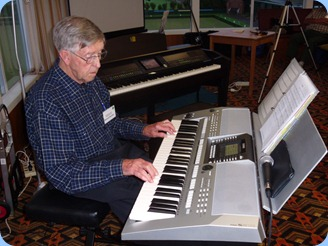 Michael Bramley playing his Yamaha PSR-910 keyboard