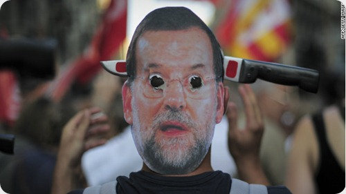 spain-rajoy-mariano-mask-protests-story-top