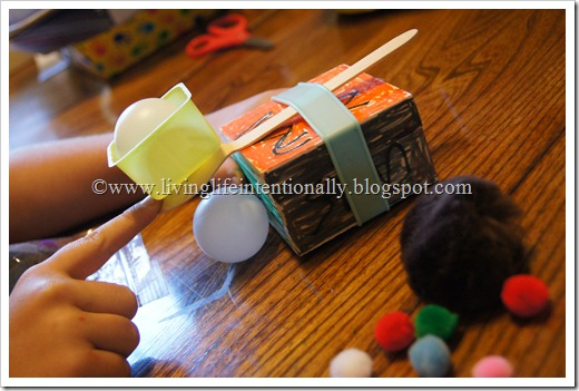 DIY Catapult Kids Activities using Pom Poms