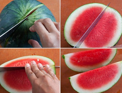 Cutting the watermelon in half and then in quarters