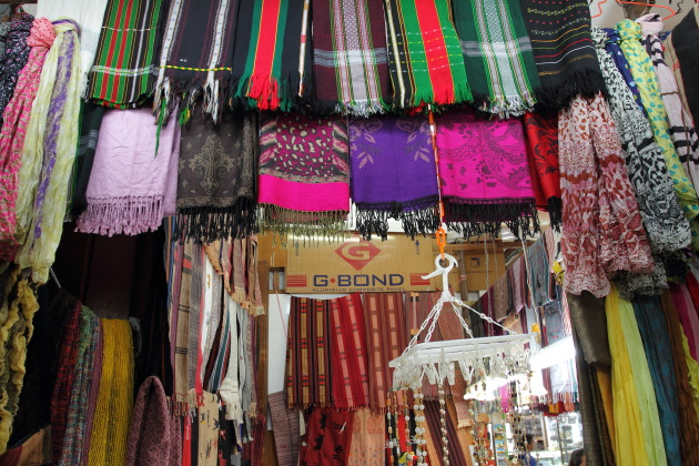 Clothes and Tribal Artifacts for sale at Bogyoke Market, Yangon, Burma