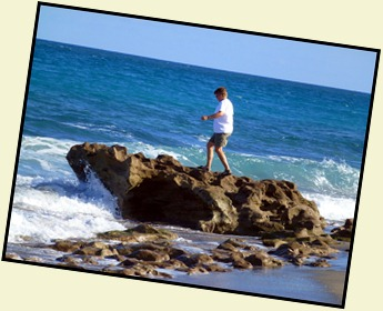 5b7b - Tour - Coral Cove - Syl Playing on Rocks