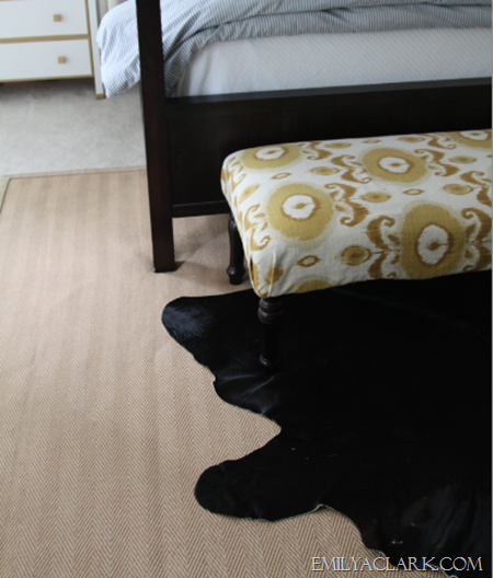 black cowhide rug in bedroom