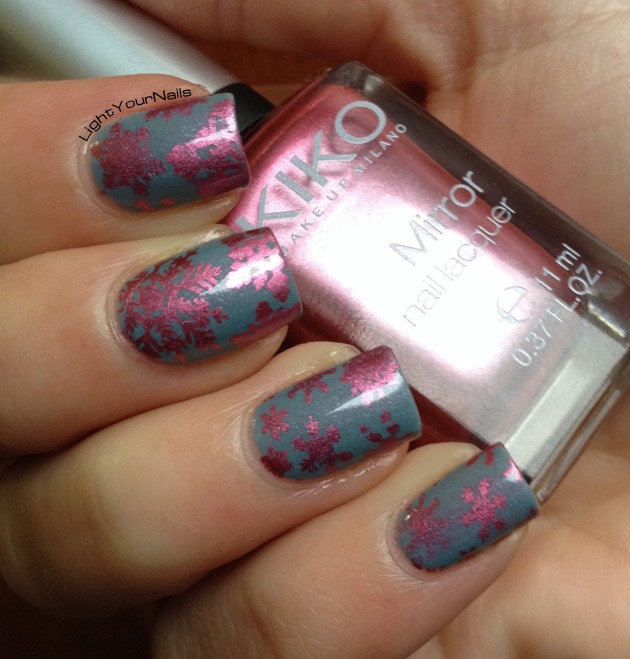 Pink snowflakes nailart stamped with QA86 plate