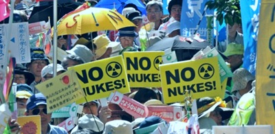 Hundreds of people marched through Tokyo waving banners to celebrate what they hope will be the end of nuclear power in Japan