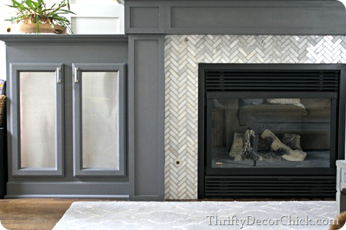 herringbone tile fireplace surround