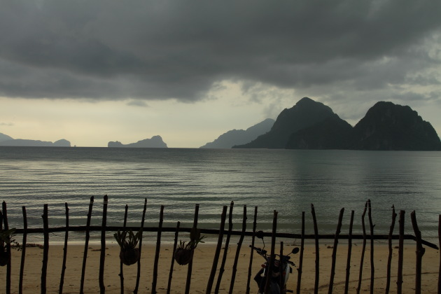 Silhouettes of the limestone karsts from Las Cabanas Beach, El Nido, Philippines