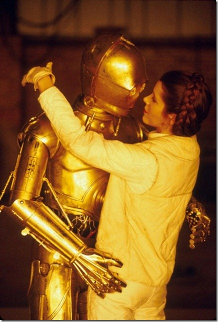 Jun 01, 1980; Los Angeles, CA, USA; Europe, South Africa, Japan, Australia, New Zealand OUT! Actor ANTHONY DANIELS stars as 'C-3PO' and Actress CARRIE FISHER stars as 'Princess Leia' on the set of Star Wars Episode V 'The Empire Strikes Back'.<br />Mandatory Credit: Photo by Lynn Goldsmith/ZUMA Press.<br />(©) Copyright 1980 by Lynn Goldsmith
