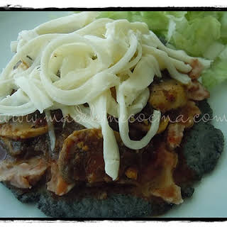 Blue Corn Tortilla with Mushrooms and Oaxaca Cheese.