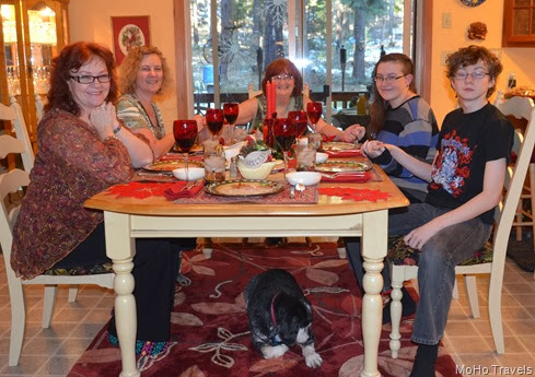 Christmas dinner table with Mo taking hte photo for us