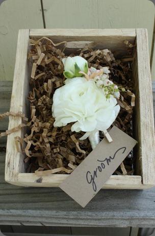 groom bout blush floral design