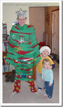 Daddy as a Christmas tree - he's a great sport!