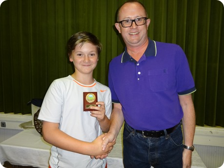 Junior winner Jack Whalley receives his shield from Alastair Bain WJTC Chairman
