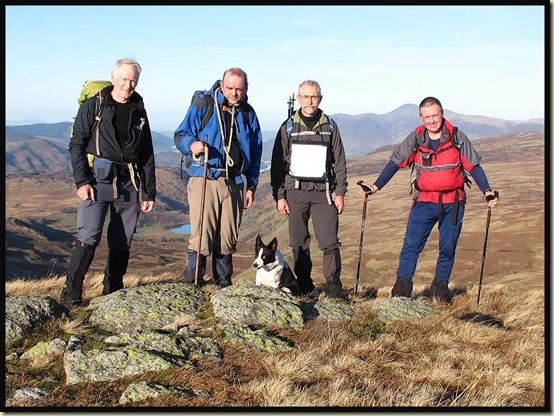 Team photo at lunchtime on Low Saddle of Coldbarrow Fell (656 metres)