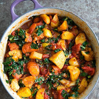 Roasted Root Vegetables with Tomatoes and Kale.