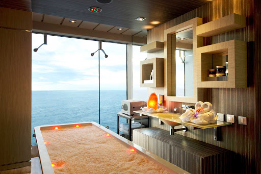 MSC-Divina-Aurea-Spa-massage-room - Make an appointment for an invigorating Balinese massage in the exotic MSC Aurea Spa, outfitted with natural stone and wood finishes and floor-to-ceiling ocean views.