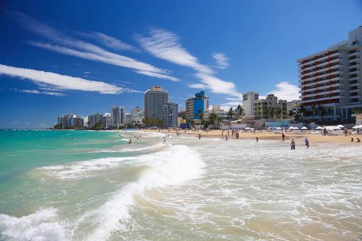 Hotels line the beachfront of Isla Verde Beach in Puerto Rico.