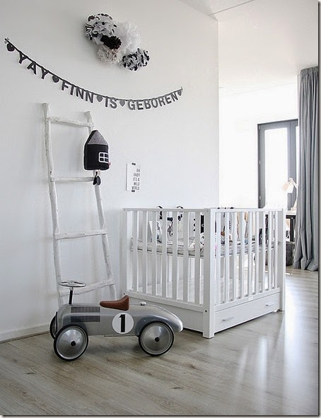 white-nursery-room-in-Scandinavian-style-contains-white-crib-and-white-ladder