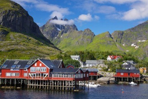 14712690-picturesque-village-on-lofoten-islands-in-norway-surrounded-by-high-peaks-of-mountains