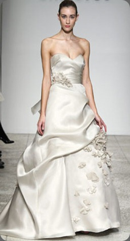 wedding dress poeme Silk Satin-Faced Organza. Strapless organza gown with sweetheart neckline, full skirt with draping and scattered flower petals. Available in Oyster as shown christos