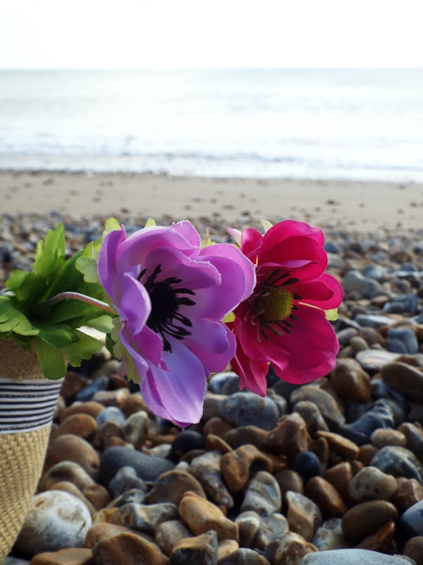 fake flowers at the beach