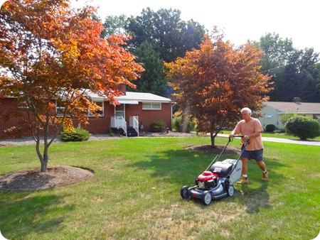 Paul mowing grass.