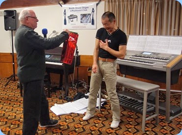 MC for the evening, Laurie Conder, presenting Taka with a couple of bottles of wine as a token of the Club's appreciation for his Concert - sometimes money cannot compensate for the six months practise to ensure near perfection! Photo courtesy of Dennis Lyons.