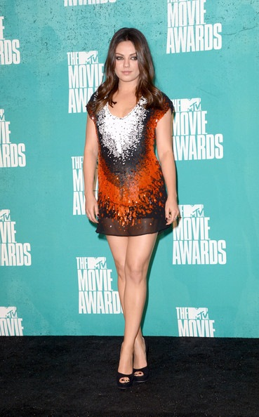 Mila Kunis poses in the press room during the 2012 MTV Movie Awards
