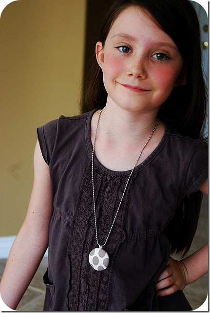 ella wearing covered button necklace