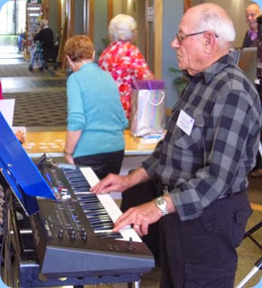 Club Treasurer, Laurie Concer, playing his new Roland BK-9 arranger keyboard.