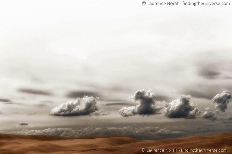 Clouds surreal australia sand dune scaled