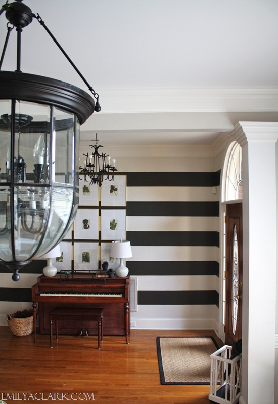 large lantern pendant and chandelier in foyer