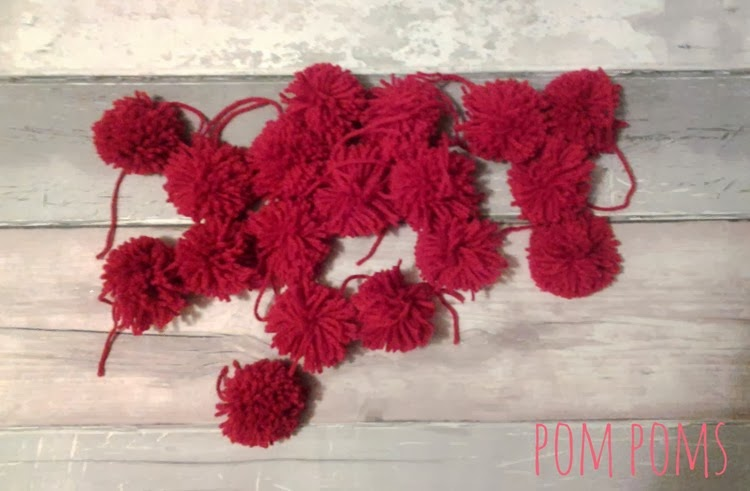 red yarn pom poms