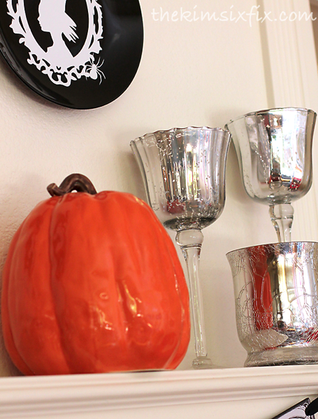Silver and orange mantel