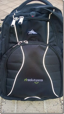 Backpack with RL Solutions logo