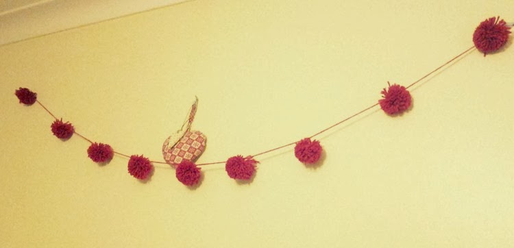 diy red yarn pom pom garland