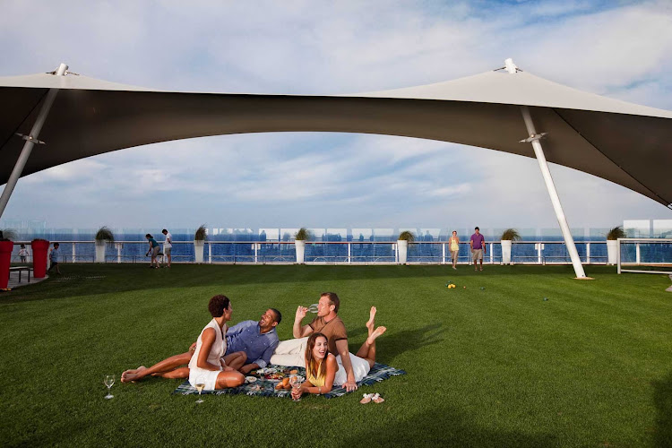 The expansive lawn area of Celebrity Solstice is the ideal spot for a picnic with friends.