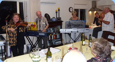 Left to Right: Marian Burns, Peter Brophy, Jan Johnston and Kevin Johnston accomanying with a percussive instrument/shaker