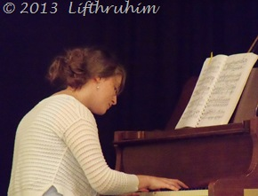 Boobear plays the piano during the recital