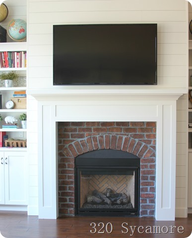 brick arch fireplace built ins