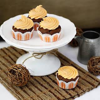 Chocolate Pumpkin Cupcakes with Orange Pumpkin Cream Cheese Frosting.