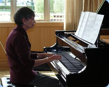Colleen Kerr playing the grand piano. Photo courtesy of Dennis Lyons.